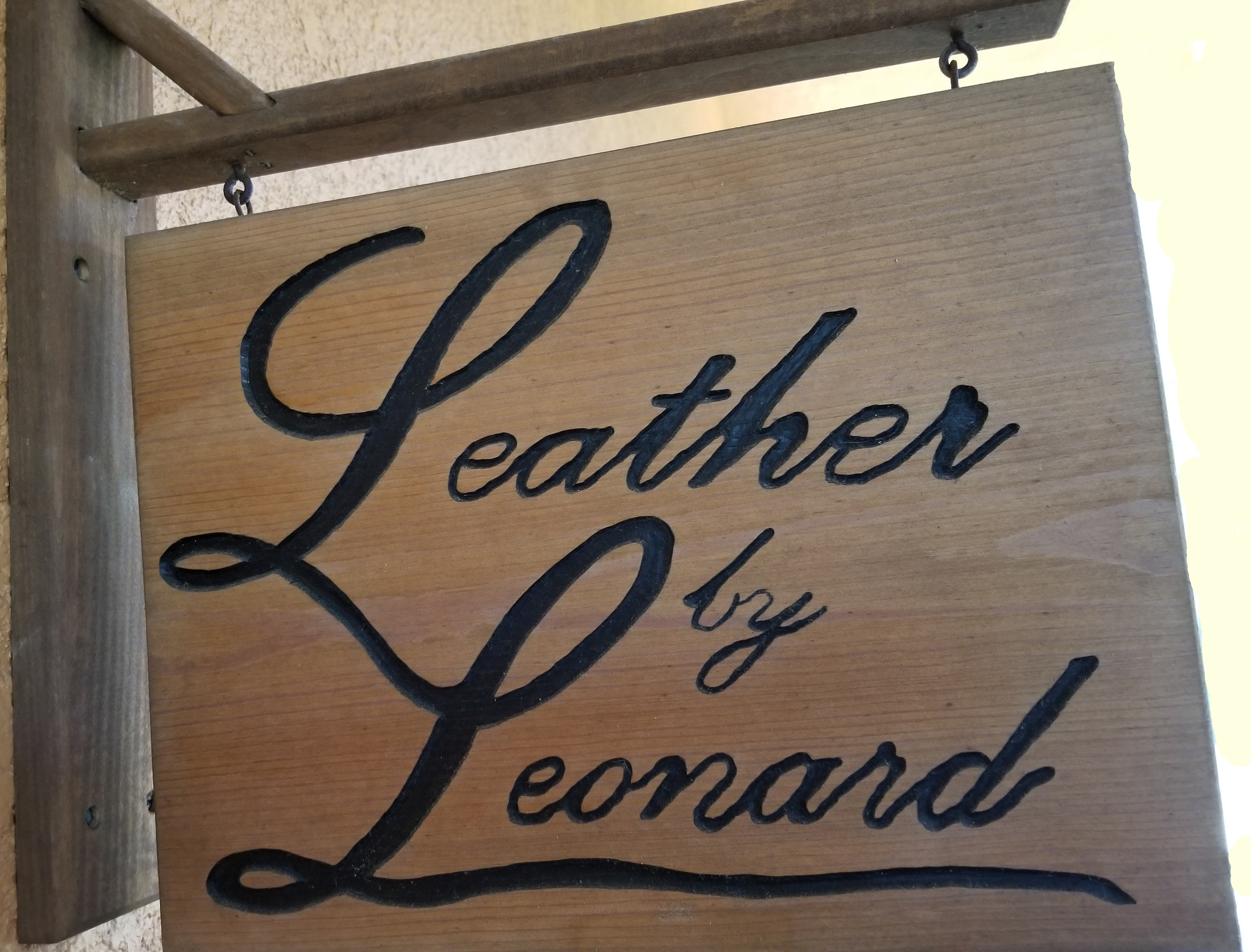 Leather By Leonard Sign